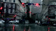Traffic travels through a wet intersection in downtown New Orleans, Louisiana. Available in HD.