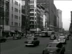 B/W 1949 traffic + trolleys on wide city street / possibly Houston or New Orleans