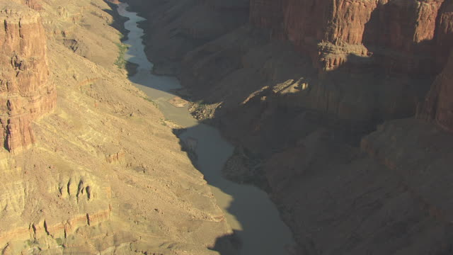 WS AERIAL Trail Colorado River past confluence with Little Colorado and large shadow over river in Grand Canyon / Arizona, United States
