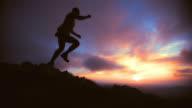 SLO MO trail runner-silhouette jump