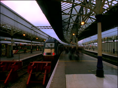 Train arrives at station and passengers alight