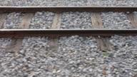 Train axle on rails.