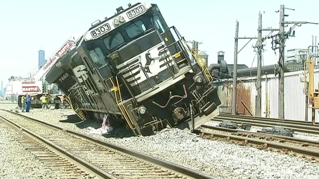 WGN Train Cars Tipped Off Train Tracks on June 13 2013 in Chicago Illinois
