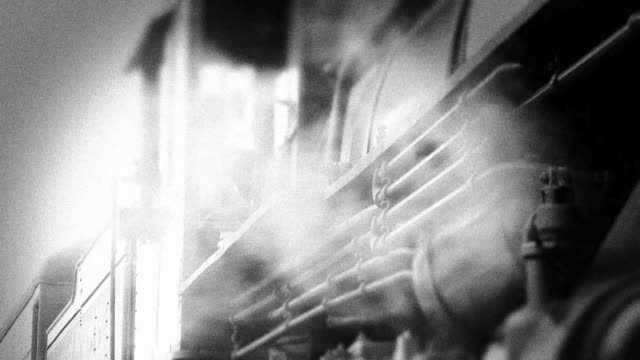 Train Conductor in Steam Engine Locomotive - BW