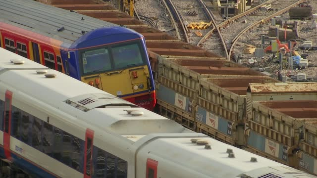 Train derails at Waterloo station causing delays ENGLAND London Waterloo EXT Various shots derailed South West Trains train near Waterloo station...