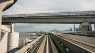 MS POV T/L Train moving on track on Yurikamome line during daytime / Tokyo, Japan