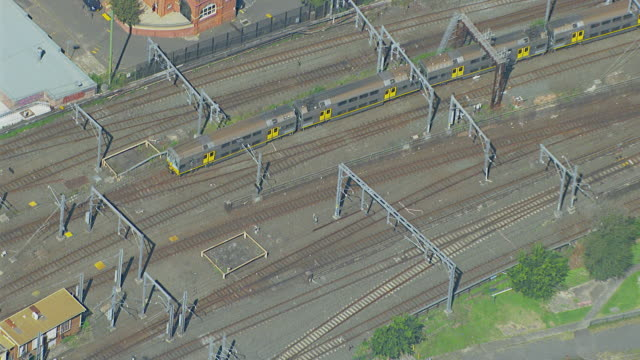 WS AERIAL ZI ZO Train moving on track / Sydney, New South Wales, Australia