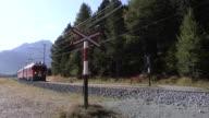 Train on the Bernina Railway between Morteratsch and Pontresina