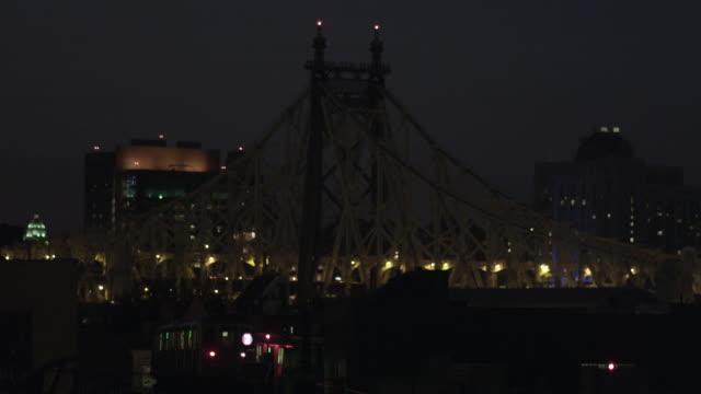 CU Train passes Queensboro bridge background