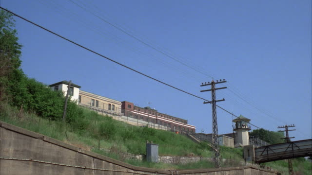 CU train passing in front of Sing Sing Prison, Ossining, New York, USA