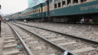 Train passing through the Karwan slum, Dhaka, Bangladesh, Indian Sub-Continent, Asia