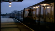 30 Train pulls in to Lichfield station commuters out Mid Staffs of train DUSK train pulls in to station Lichfield ITN EXT/DAY Rugeley 0403 GV...