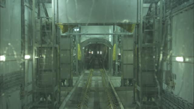 A train travels through a washing system.