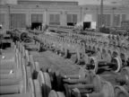 Train wheels stored outside in wheel pit workers inside lowering wheel to onto machine grounding smoothing wheel worker inspecting roller bearing...