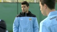 train with their Manchester City team mates ahead of their UEFA Champions League game against Napoli Carlos Tevez and Sergio Aguero on September 14...