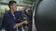 DS ZO trainee in aviation mechanic training facility working on a turbofan jet engine