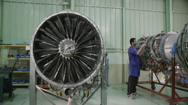 WS PAN trainee in aviation mechanic training facility working on a turbofan jet engine