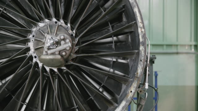 PAN trainee in aviation mechanic training facility working on a turbofan jet engine