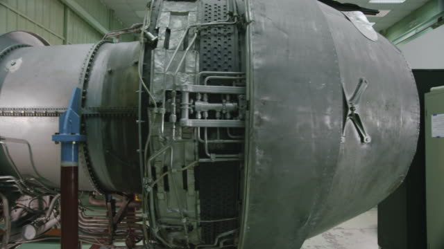 DS trainee in aviation mechanic training facility working on a turbofan jet engine