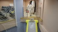trainees in aviation cabin crew class practicing emergency egress via an emergency slide, RED R3D 4k