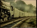 1941 MONTAGE Trains traveling along a railroad / United States