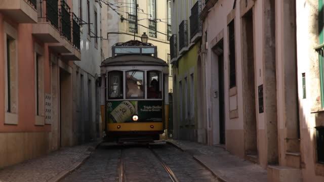 WS Tram in narrow alley / Lisbon, Portugal
