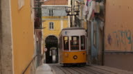 WS Tram in old town alley / Lisbon, Portugal