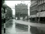 A tram moves along a high street in Belfast