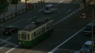 A tram travels along a road in Nagasaki.