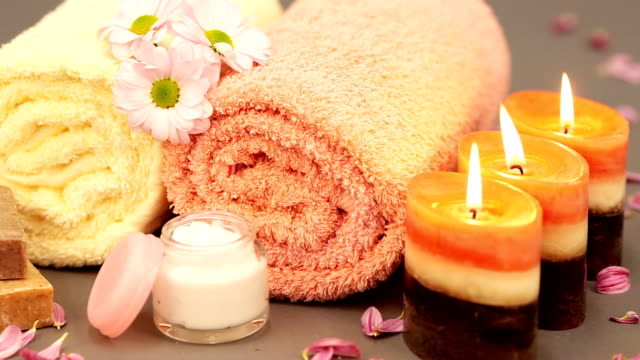 Tranquil scene of candles and spa decoration.