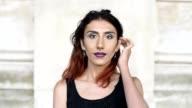 Transgender female looking to camera