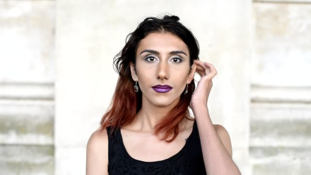 Transgender female looking to camera