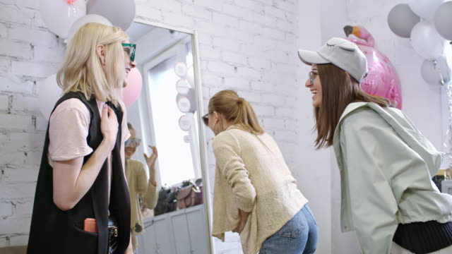 Transgender person and female friends choosing sunglasses