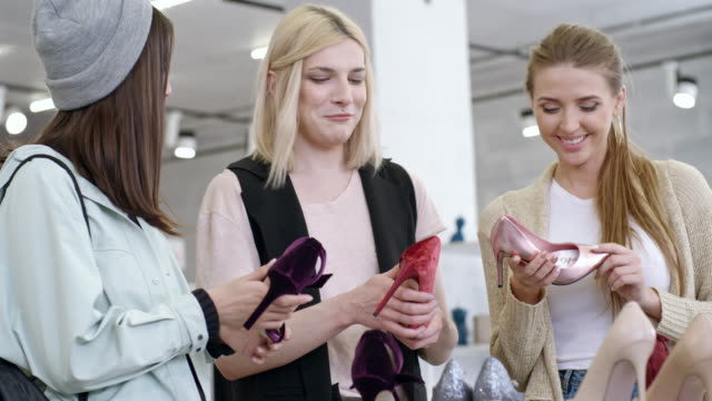 Transgender person and female friends discussing new shoes collection