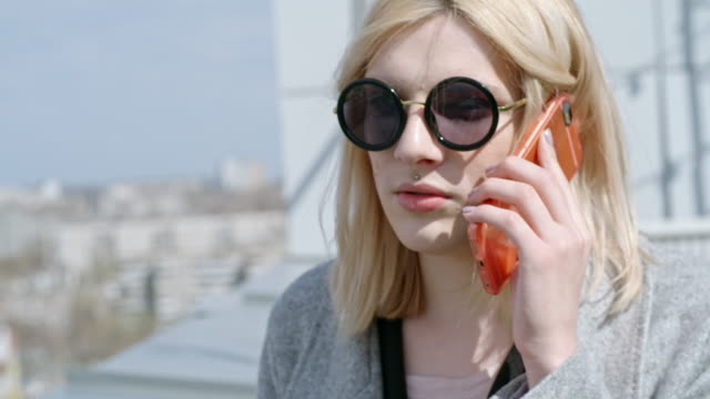 Transgender person chatting on mobile phone outdoors