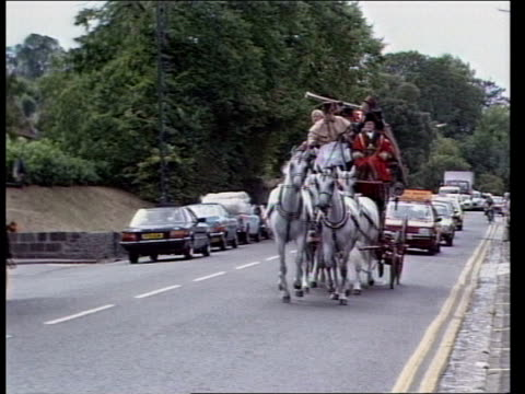 Old Mail Coach ENGLAND Bristol MS Royal Mail stage coach leaves RL MS Signpost MS Coach on the road towards as man blows horn SOF 'Well the coach...