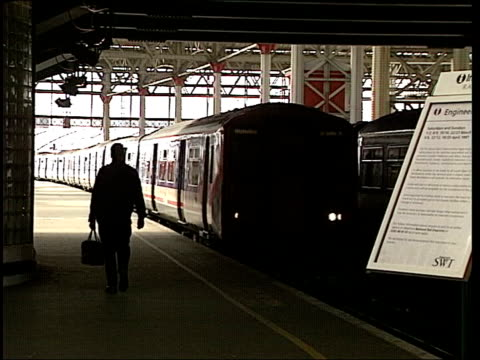Railways South West Trains Strike Suspended ITN ENGLAND London INT Train arriving at station platform Passengers from train
