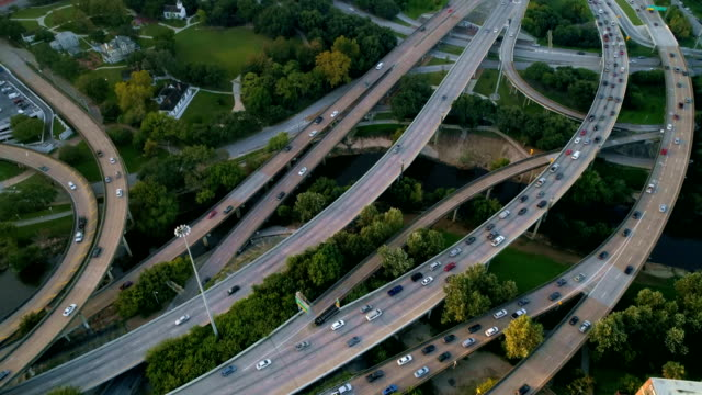 Transportation Highway Mega Road ways travel destination aerial drone view down at Roads at Rush Hour Houston , Texas Aerial Drone View at Sunrise