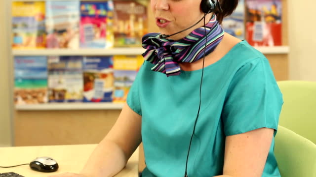 Travel Agent taking a vacation holiday booking over the phone