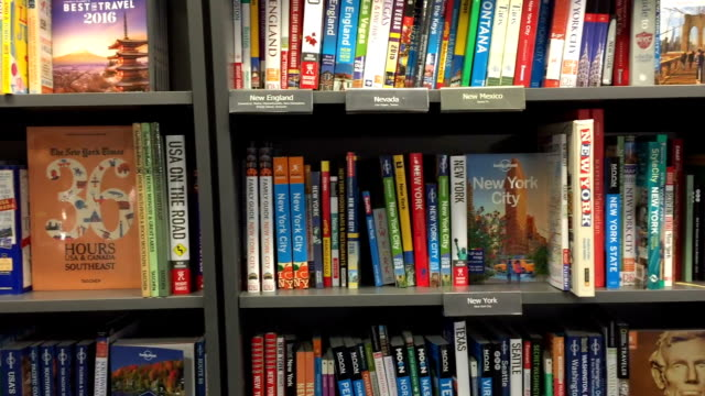 Travel books in a bookshop or library