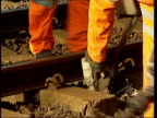 Travel chaos / British inequality ITN Workers working to repair the railway tracks