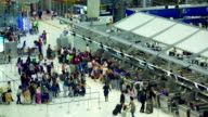 Traveler Crowd at Airport Check In Counter Hall