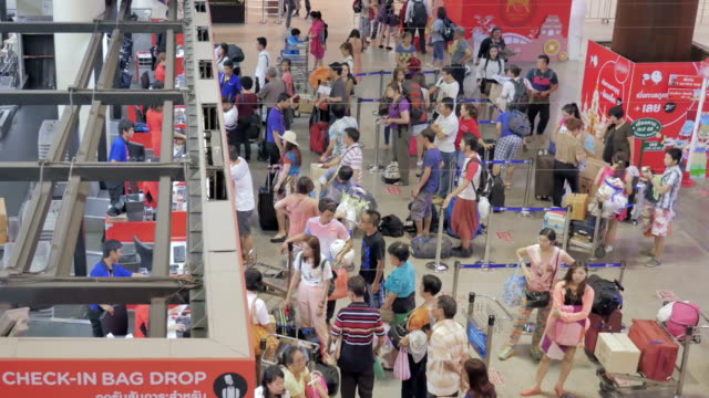Traveler Crowd at Airport Check In Counter,High Angle View