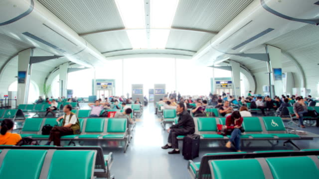 Traveler Crowd at Airport waiting hall before departure time lapse
