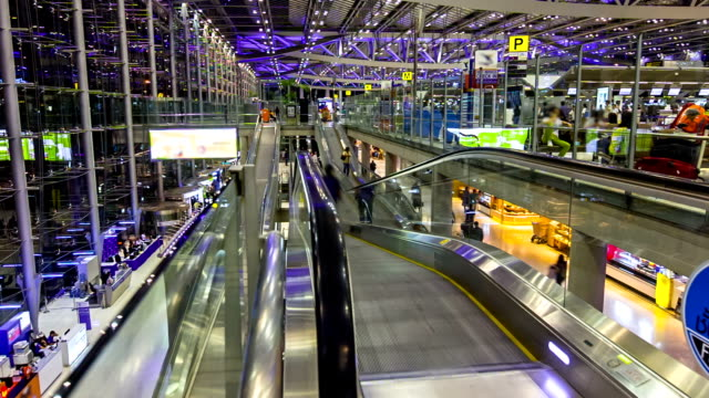 Traveler in the airport escalator,Time lapse
