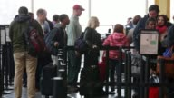 Traveler wait inline at a security check point at Ronald Reagan Washington National Airport on the day before Thanksgiving which is usually the...