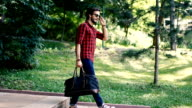 Traveler walking in park