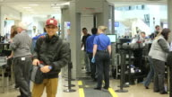 Travelers enter a security check in line inside a terminal at the Salt Lake City International Airport in Salt Lake City Utah Passengers place their...