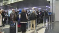Travelers Getting Boarding Passes Checked At Airport at Chicago O'Hare Airport on December 20 2013 in Chicago Illinois