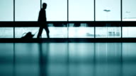 Travelers silhouettes at airport